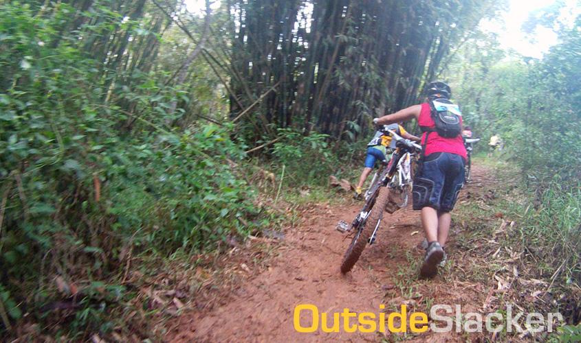 Biker pushing his bike in Timberland's Blue Zone