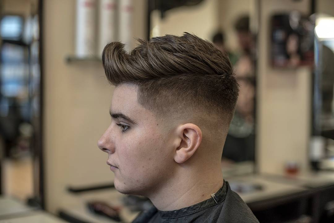 Fade with textured thick hair and curl at front