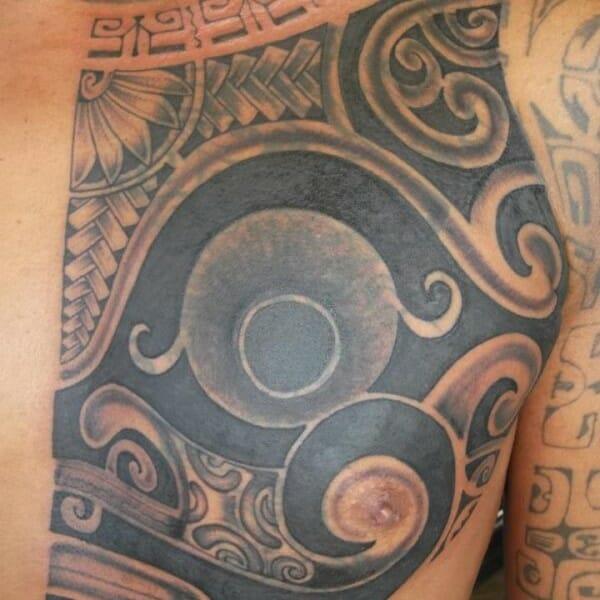 Half Polynesian Chest Tattoo