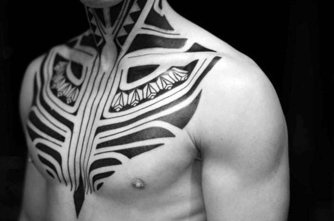 Black Ink Tribal Chest Tattoo