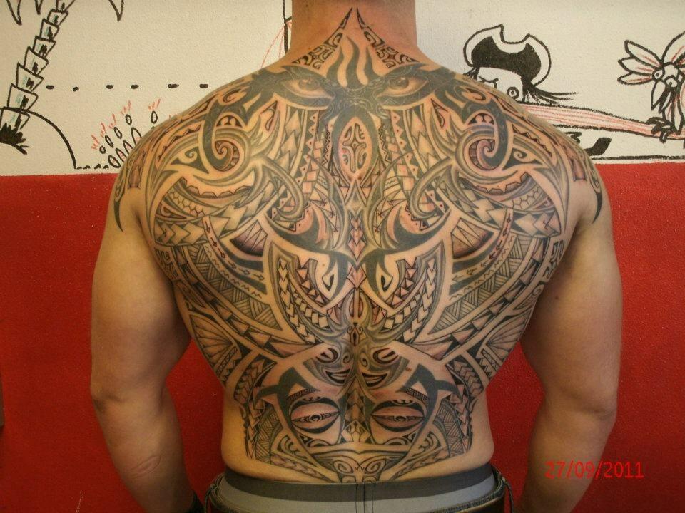 Amazing Tribal Back Tattoo