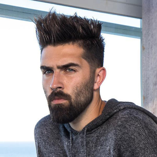 Taper Fade with Medium Length Spiky Hair and with Full Beard