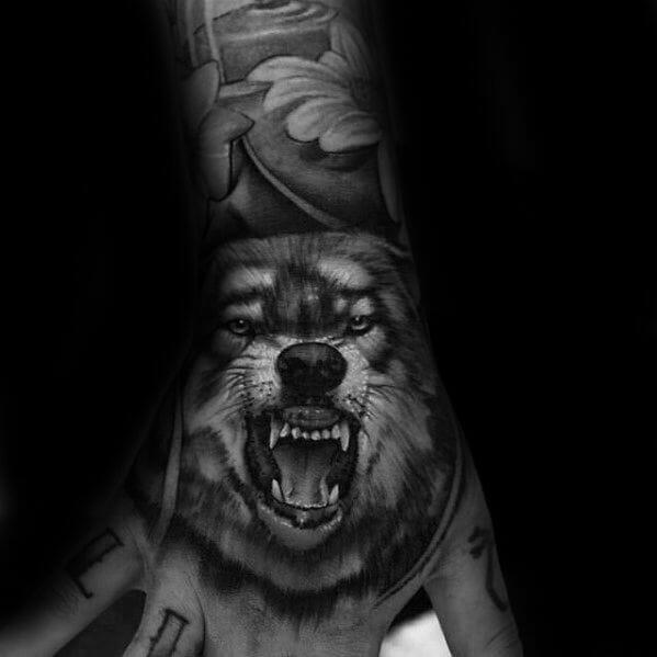 Realistic Wolf Hand Tattoo