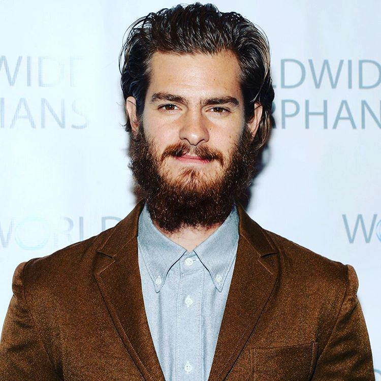 Andrew Garfield with Brown Slicked Back Hair And Messy Verdi Beard