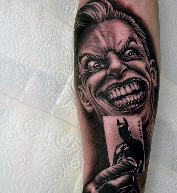 The Joker Holding a Playing Card with Batman on it Tattoo Sleeve