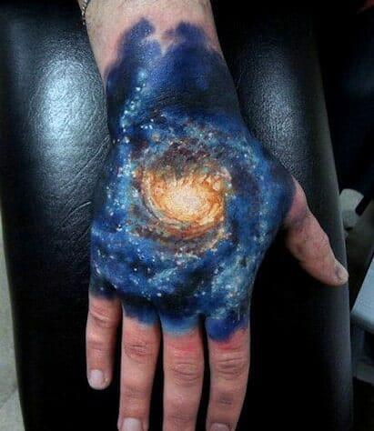 Galaxy Hand Tattoo