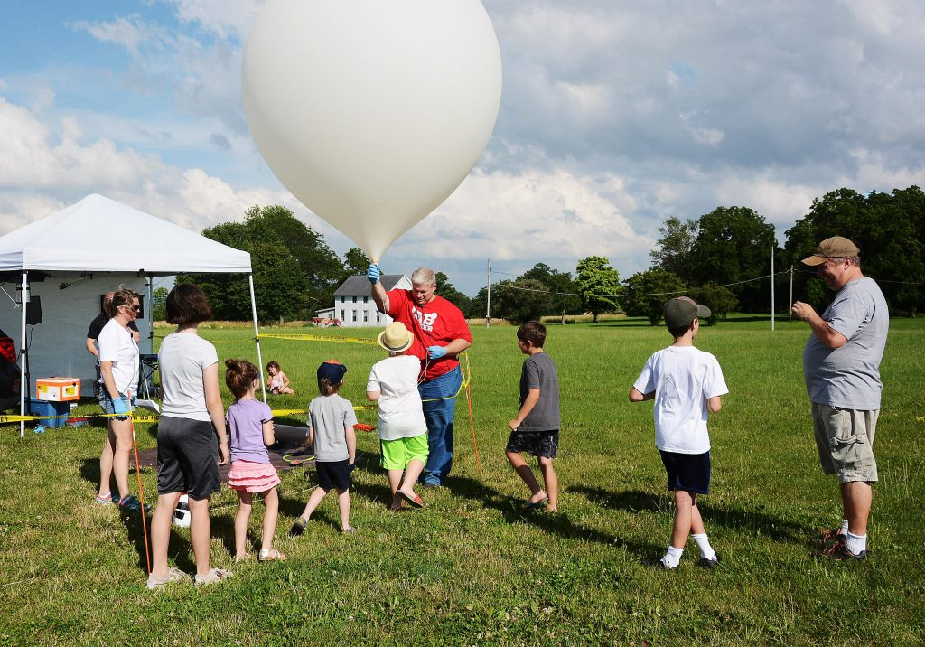 Kids enjoying our weather balloon launch operations!