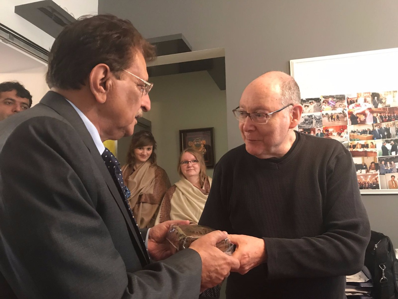 Brussels: Ambassador Anthony receives a shield from AJK's PM Raja Farooq Haider