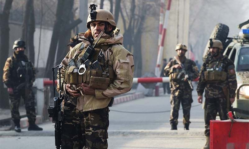 Afghan Security Personnel keep watch near the site of suicide attack - AFP