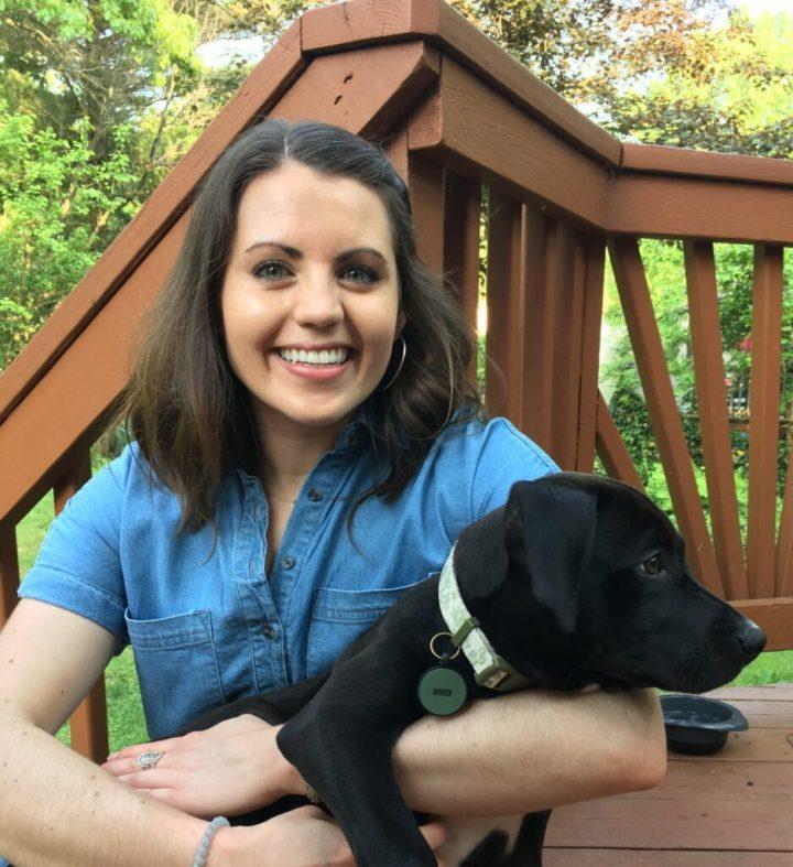 Marissa holding a puppy