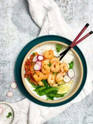 Healthy shrimp rice bowl with kimchi and chopsticks