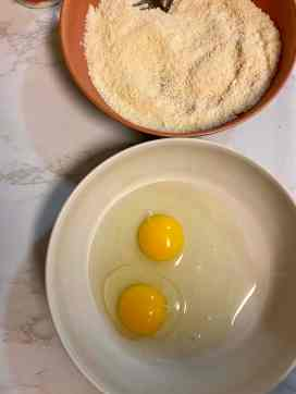eggs and parmesan in shallow bowls