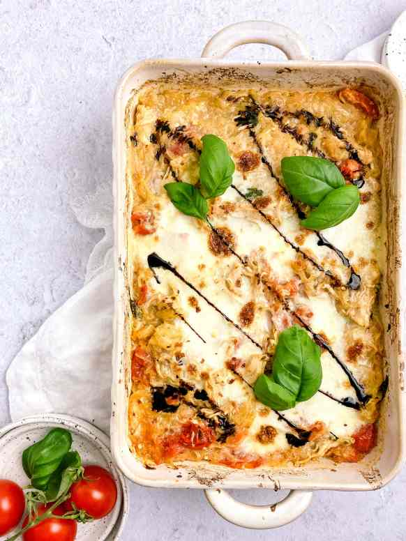 casserole topped with basil, cheese, and balsamic