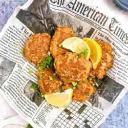 tuna patties on newspaper