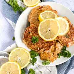 tuna patties with lemon slices on a plate