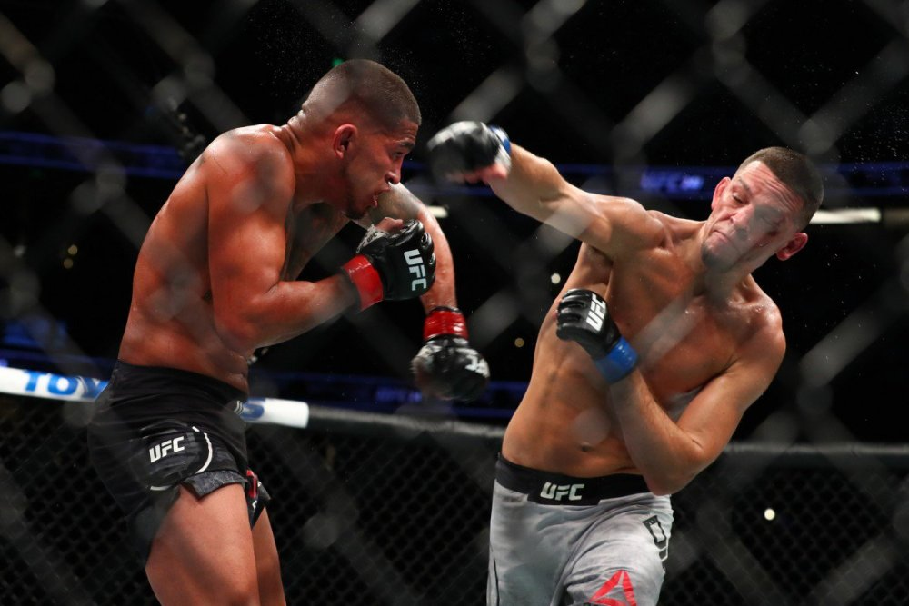 Nate Diaz throws a punch at Anthony Pettis in the second round. Photo: AFP