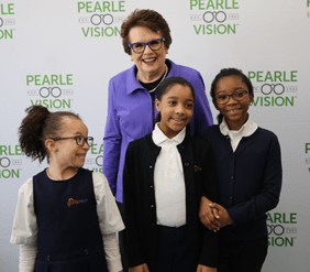 Billie Jean King and girls during a Pearle Vision event