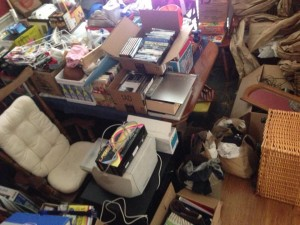 Oct. 22, 2014 This landfill used to be our dining room. For the past month, it's served as the staging area for our community-wide yard sale on Saturday. And this isn't even all of it. Objective: To bring in enough cash to cover the cost of the yard sale permit plus the November RV loan payment!