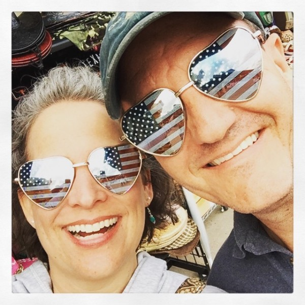 We did not buy these sunglasses; we just used them for this selfie, after choosing them simultaneously, from opposite sides of a display rack at a flea market. Then we put them back. It's one of many ways we own less.