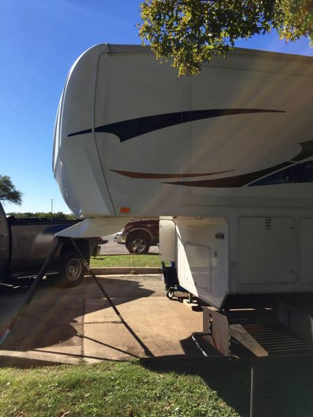 """I am 5'4"""". That overhang, which is our bedroom floor, is about 5'2"""" off the ground. And that is how we bonk our heads on it -- a lot -- when walking around the RV."""