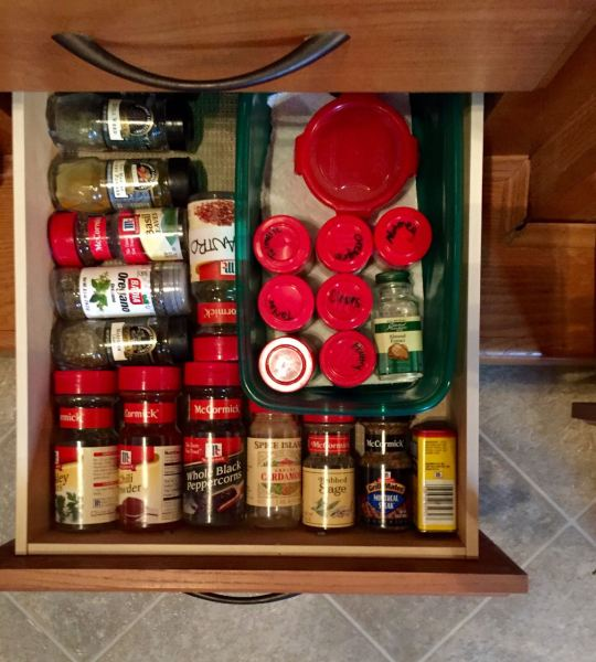My favorite RV kitchen storage solutions: keeping spices in a drawer. They slide around and topple over in a cabinet. And we need that space for cereal boxes and canned goods anyway.