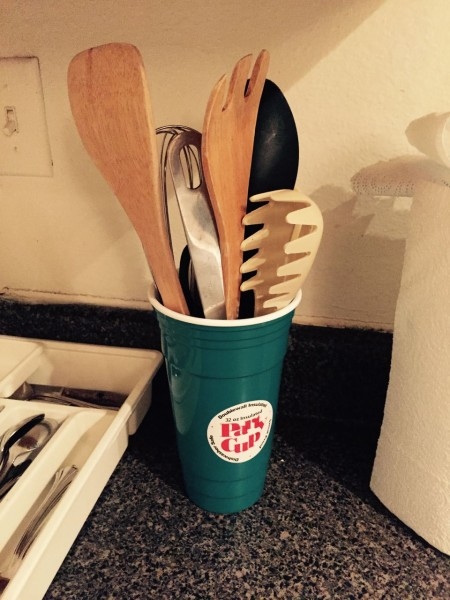 """This is the utensil caddy in our younger son's apartment, so I guess now it's a family tradition?  Also, never send your husband into Walmart to buy a utensil caddy. Especially if you tell him it's for spatulas and big spoons, and """"kind of like a big cup."""""""