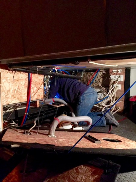That's my guy, in the guts of this here rig, fixing a water leak in the basement. Yes, we have one. It's a forward compartment under the bedroom.