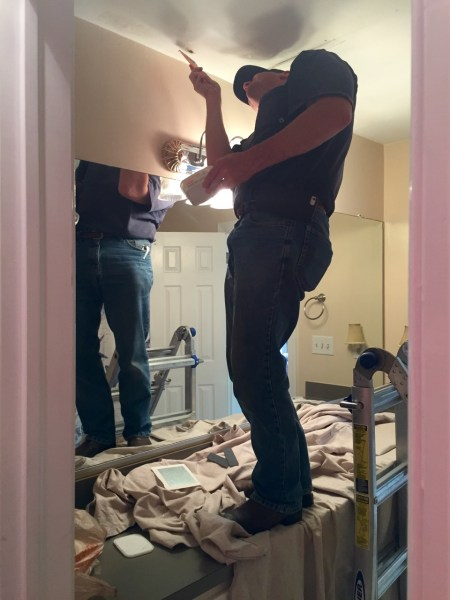 Inside job: repairing drywall in the bathroom. Ceiling paint to follow...