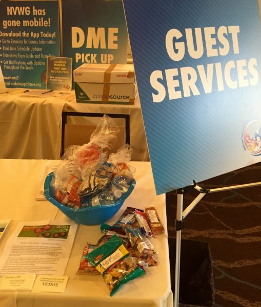 Next morning, I helped staff the NVWG Guest Services table at the Sheraton. We were stocked with items the athletes might need: bus schedules, dining guides, city maps, snacks, water bottles, etc. Seemed like a great place to set out the Gloves for Life cards!