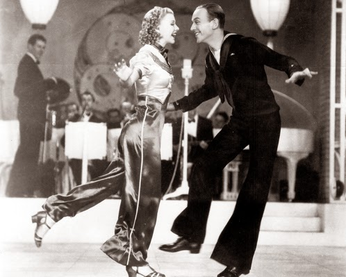 Ginger Rogers doing it backwards and in high heels with Fred Astaire in Follow The Fleet.