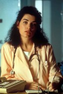 Julianna Margulies in the TV show ER. Instead of snakes, she has a stethoscope