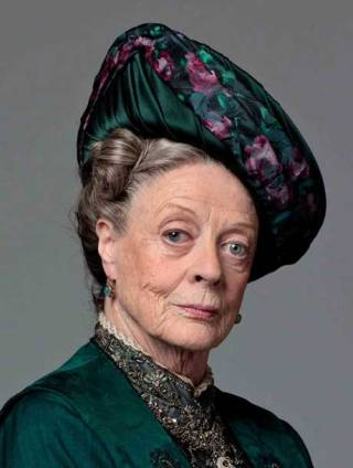 Maggie Smith as the Dowager Lady Thingamajig in Downton Abbey.