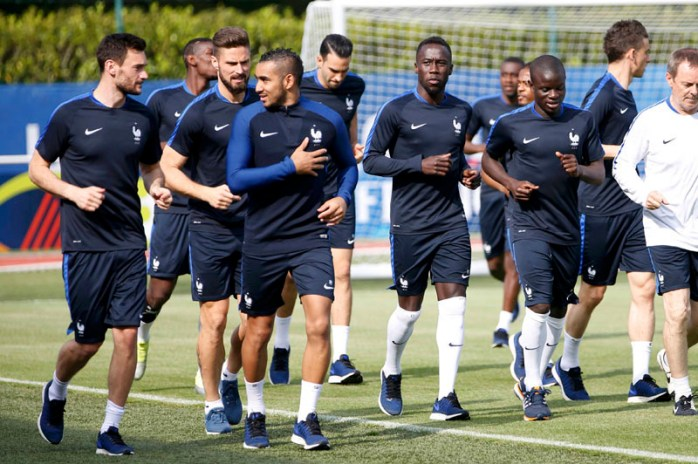 A herd  of French footballers training.