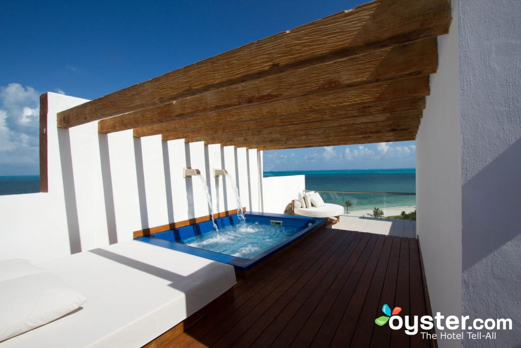 The Excellence Club Two-Story Rooftop Terrace Suite with Ocean Front at the Excellence Playa Mujeres