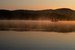 We were up early and ventured down to the lakeside to see the sunrise. Fortunately the water was still very warm as I had to wade in up to my waist to get these pictures of two fishermen who were quietly trolling the lake.