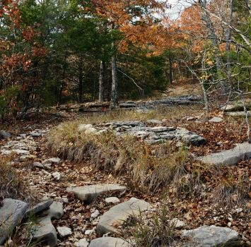 On the steep trails, the water tends to wash away the dirt exposing rugged rocks. The steeper it is, the more rocks. This is particularly nasty to descend. Lake Trail - Piney Creek Wilderness