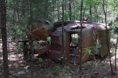 Photograph of an abandoned vehicle in the woods at Busiek State Forest and Wildlife Area