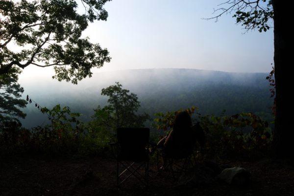 Photograph of Ginger Davis Allman watching the sun rise over the Huzzah Valley