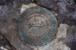 At the summit of Bell Mountain in Iron County, Missouri, we found this survey marker. It was hard to read. I think someone took the warning about defacing it as a challenge.