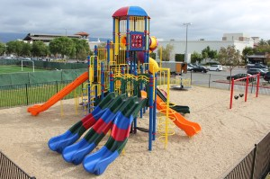 Kids on the Go Playground With Swings and Merry-Go-Rounds