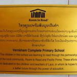 a sign that outlines the school in vientiane has been built with the support of room to read and pacific prime