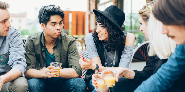 young people chatting about employee benefits for millennials