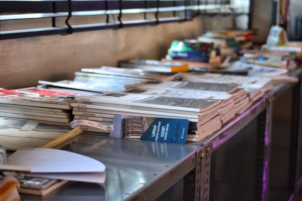Hostel Indoors Community Space Books - Fabrika Hostel Tbilisi   Packs Light