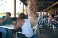Patio seating area built around a palm tree
