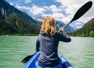 kayak surrounded by beautiful mountains