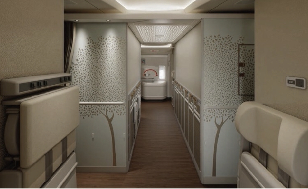 The refreshed cabin interior has swapped desert themed interiors of motifs of the Ghaf tree. The galley's now feature roller blinds to hide away unsightly canisters. Photo Credit: Emirates