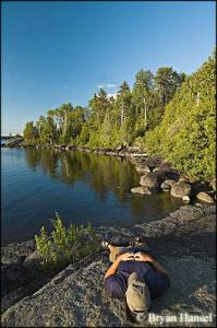 Bryan Hansel relaxes on Lake Alice in the BWCA
