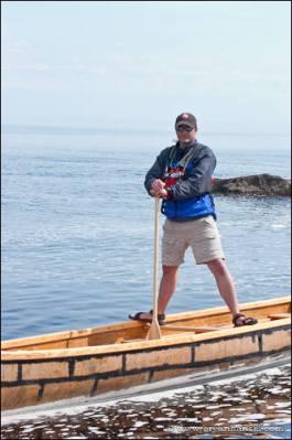 Standing on canoe gunwales in a Voyager canoe