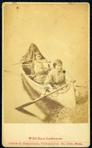 Ojibwe women and children in a canoe. Photographer: Charles Alfred Zimmerman (1844-1909) Photograph Collection, Carte-de-visite ca. 1885