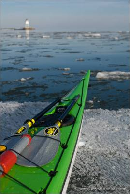 Kayak on a Lake Superior ice pan. Grand Marais, MN.